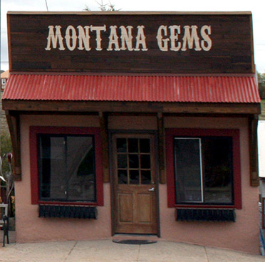 Montana Gems retail storefront in Philipsburg, Montana. The cute blue building with the bright yellow door!